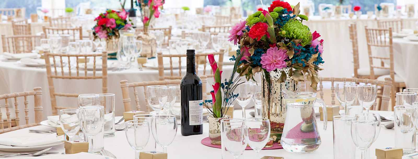 colourful flowers in marquee dining area