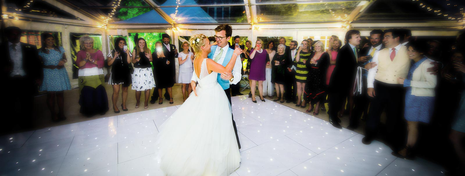 bride and husband dancing on marquee dancefloor