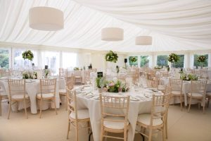 Dining tables in a marquee