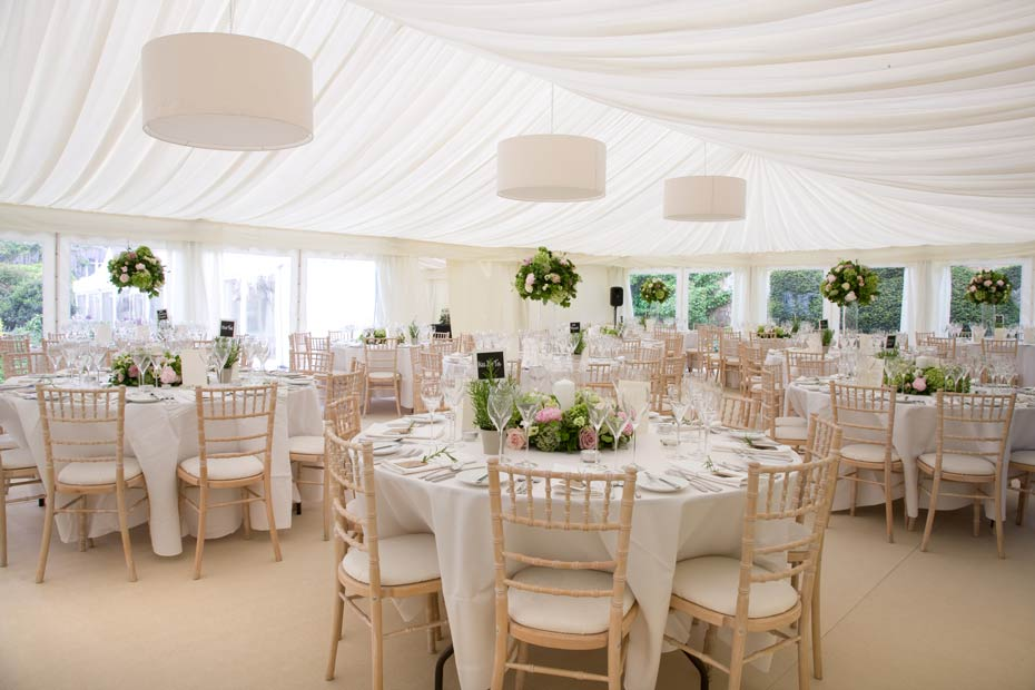 wedding dinner tables in a marquee