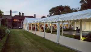 marquee in garden designed to incoporate water feature