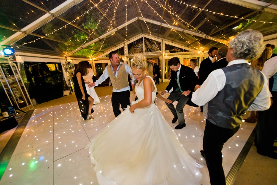 bride and groom dancing in a wedding marquee