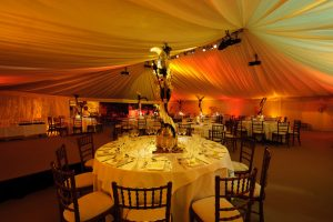 Table decorations in African savanna themed marquee