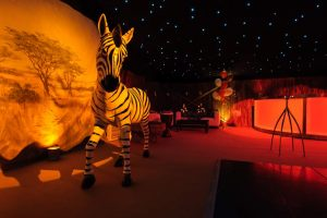 African savanna decorations in themed party marquee