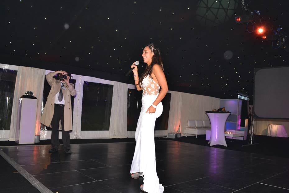 bride singing in nightclub themed marquee