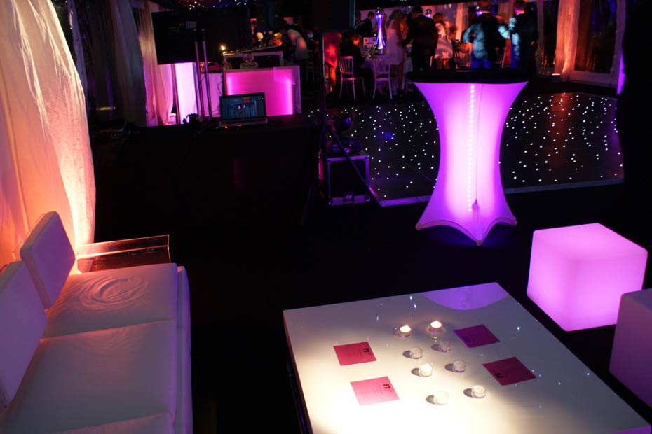 table and chairs in nightclub themed marquee