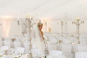Bride in white wedding marquee