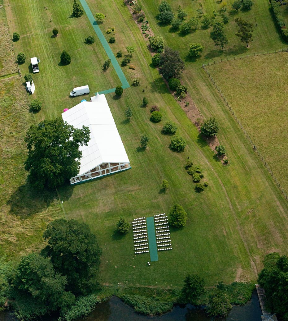 ariel view of a wedding marquee and outdoor ceremony