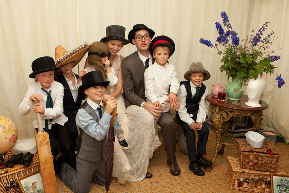 family using props in explorer themed wedding marquee