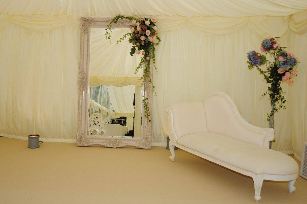 chaise lounge in a wedding marquee