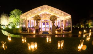 glass wedding marquee lit up at night