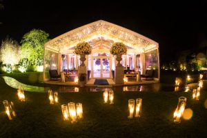 Beautiful glass marquee lit up at night in the grounds of Le Manoir aux Quat Saisons