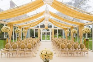 Glass marquee set up for wedding ceremony held in the grounds of Le Manoir Aux Quat' Saisons