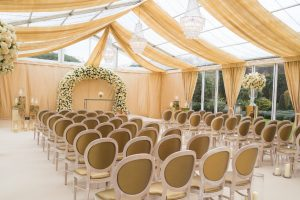 Stunning glass marquee set up for wedding ceremony at Le Manoir Aux Quat' Saisons