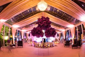 Glass marquee beautifully styled for evening wedding party