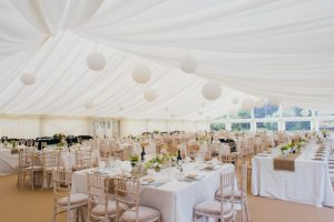 Wedding marquee uniquely styled with ivory pleated lining