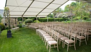 wedding ceremony in open marquee