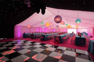 Chequered dancefloor in marquee for birthday party