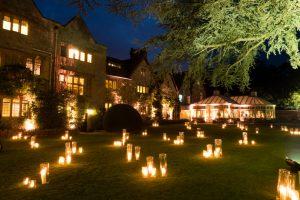 Candles illuminating the garden of Le Manoir Aux Quat Saisons