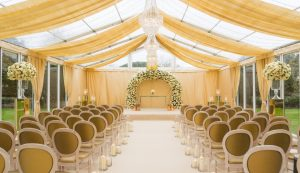 Marquee with clear gable, solid window panels, clear roof with wall & roof swags and fairy light canopy