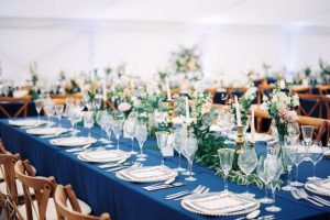 Vintage themed table layout for wedding held in marquee