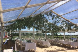 Glass marquee with unique internal styling for Vineyard event