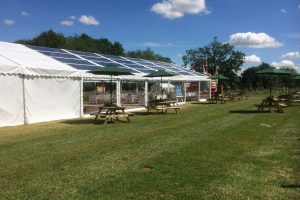 Marquee with clear roof and sides hired for outdoor event