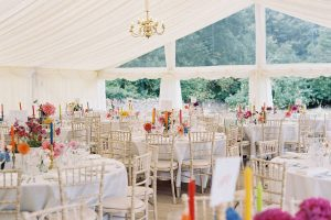 Ivory lining, chandelier, clear gable, limewash chairs