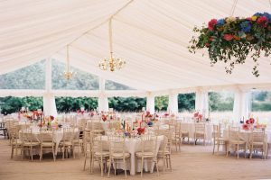Luxury wedding marquee with matting, ivory lining, chandeliers and lime wash chairs