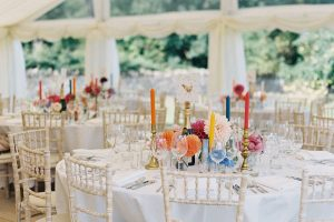 Wedding marquee styled with matting, ivory lining, clear gable, limewash chair