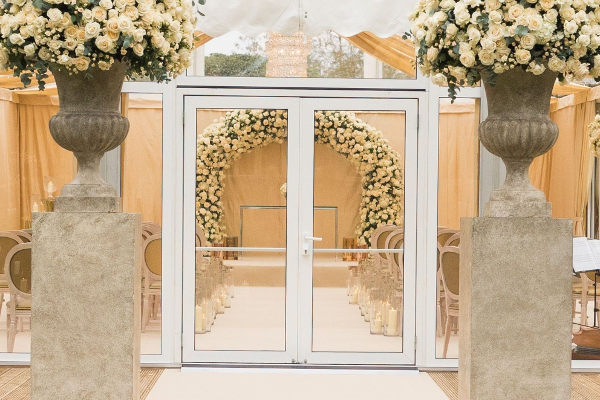 french doors leading into clear roof marquee