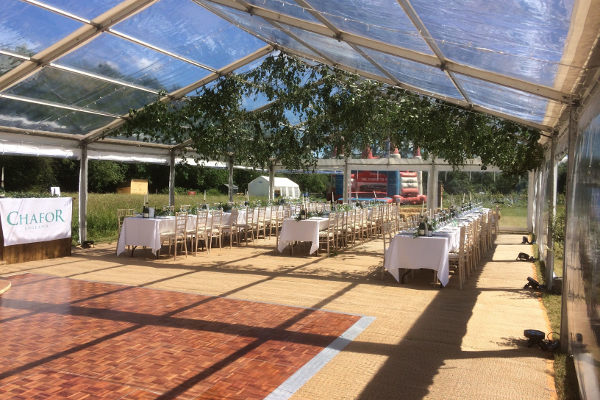 parquet dance floor in clear roof marquee
