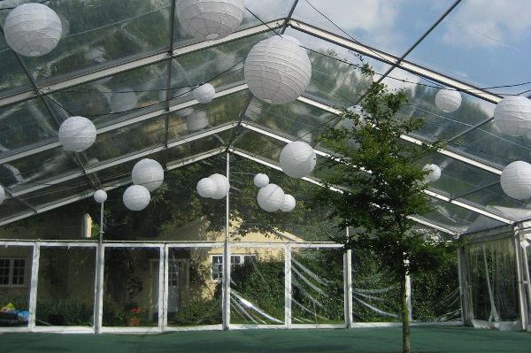 festoon of lanterns in clear roof marquee