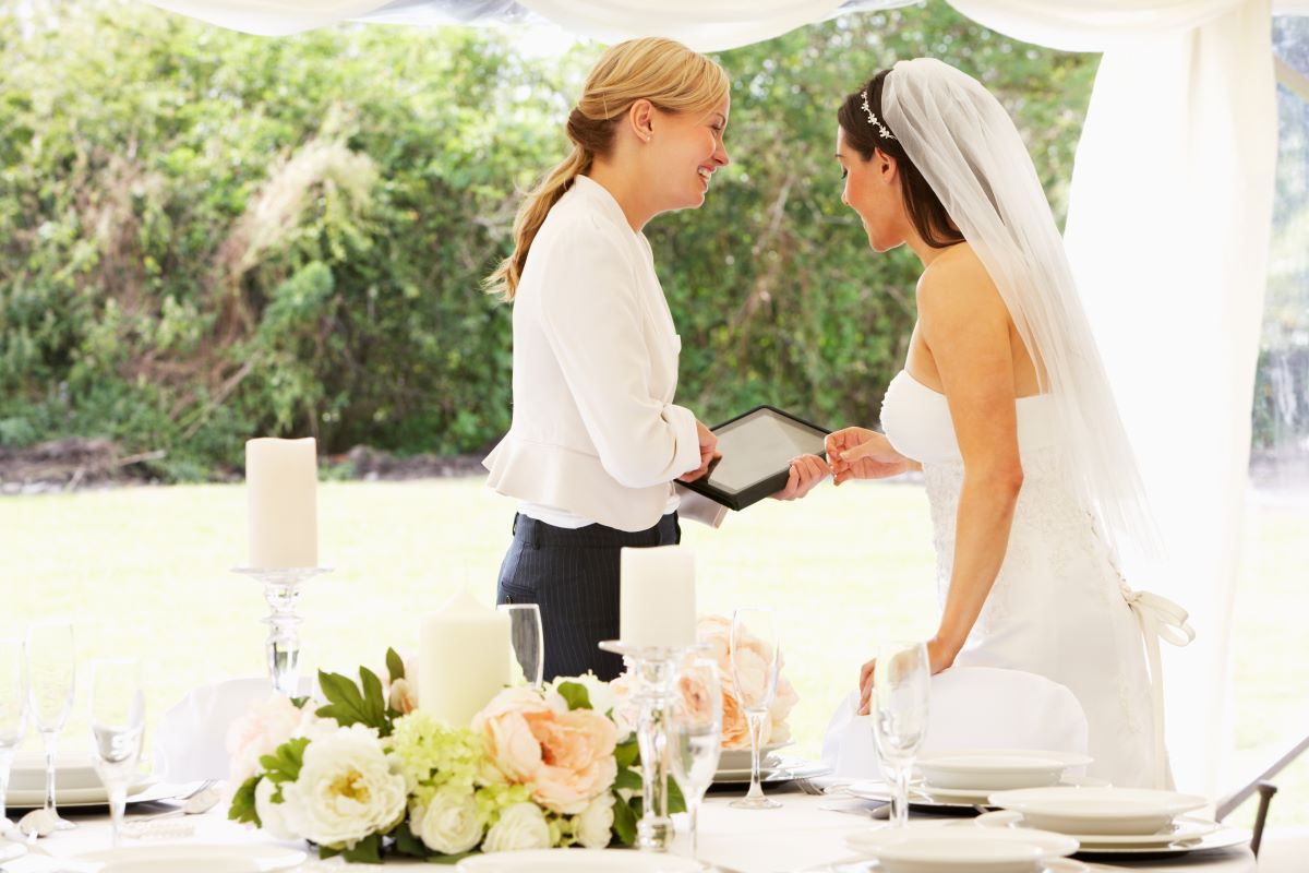 wedding planner with bride in marquee